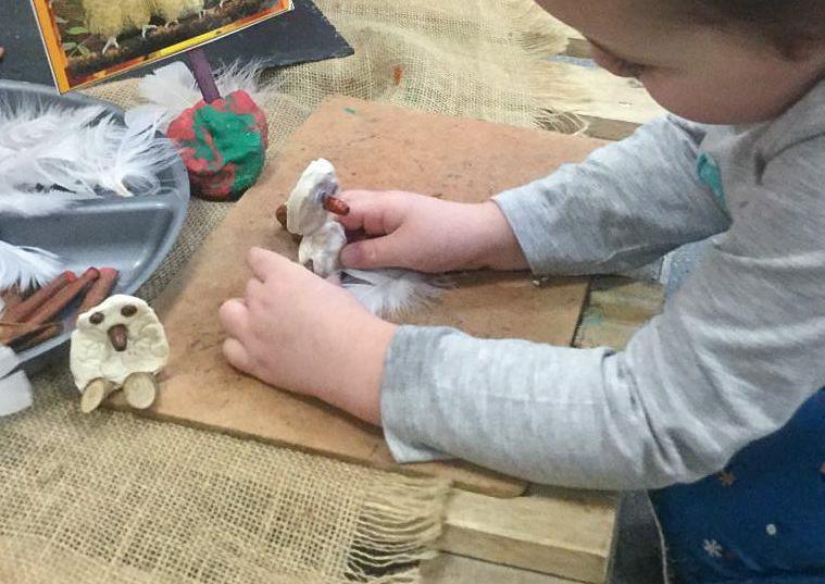 Class Image – Student Sculpting Owl and Echidna Sculptures Coil Handbuilding W